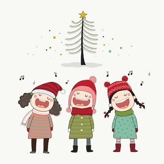 Drei kinder singen weihnachtslied mit kiefer
