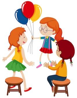 Drei mädchen und ballons