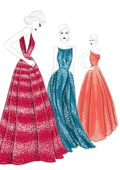 Drei modelle in couture-kleidern