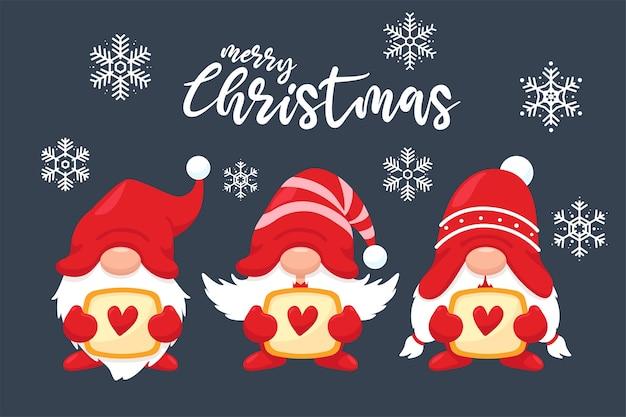 Drei niedliche weihnachtszwerge mit herzen auf dem winterschneehintergrund