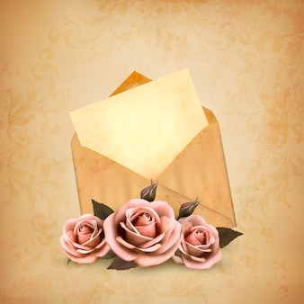 Drei rosen vor einem alten umschlag mit einem brief