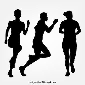 Drei silhouetten von läufern