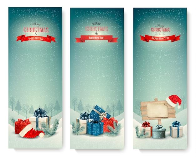 Drei weihnachtsbanner mit geschenken.