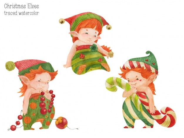 Drei weihnachtselfen mit bonbons