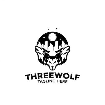 Drei wölfe kontrollieren nachts eine stadt, um ein logo zu erhalten