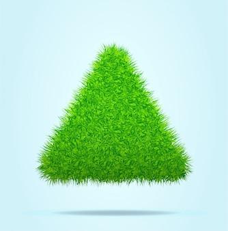 Dreieck oder pyramide des grünen grases auf einem blauen klaren hintergrund