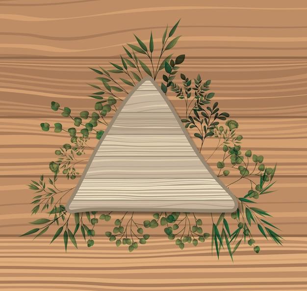 Dreieckiger rahmen mit lorbeer treibt hölzernen hintergrund blätter