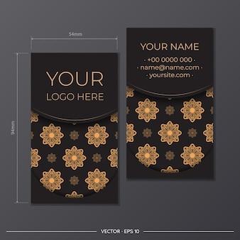 Druckfertiges visitenkartendesign mit griechischen mustern. visitenkarten-set in schwarz mit vintage-ornamenten.