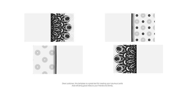 Druckfertiges visitenkartendesign weiße farben mit mandalas. vektor-visitenkarteschablone mit platz für ihren text und schwarze verzierungen.