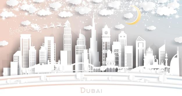Dubai uae city skyline im papierschnitt-stil mit schneeflocken