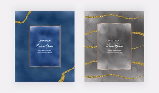 Dunkelblaue und schwarze aquarellkarten mit geometrischen rahmen und goldenen glitzerlinien