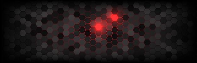 Dunkelgrauer hintergrund der technologischen bienenwabe und des roten lichtes