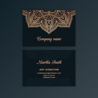 Dunkle visitenkarte mit goldenem mandala