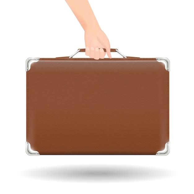 Echte braune klassische koffer reisetasche mit der hand
