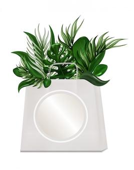 Eco beutel für die kaufenden tropischen blätter getrennt auf dem weiß.