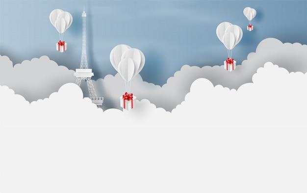 Eiffelturm paris mit ballongeschenkboxfliege auf lufthimmelkonzept