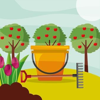 Eimer rechen apfelbäume und blumen gartenarbeit