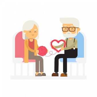 Ein älteres paar, das einen strang des garns in einer form des herzens, glücklichen valentinsgrußtag entwirrt.
