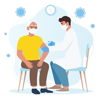 Ein arzt, der einem mann einen coronavirus-impfstoff verabreicht