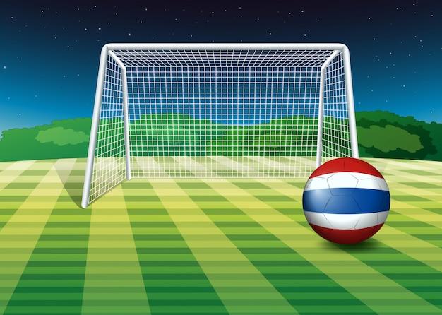 Ein ball auf dem feld mit der flagge von thailand