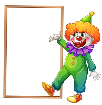 Ein clown, der auf das weiße brett zeigt