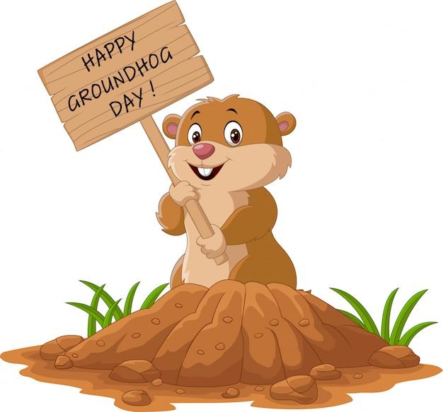 Ein frohes murmeltier tag. lustiges groundhog, das holzschild hält