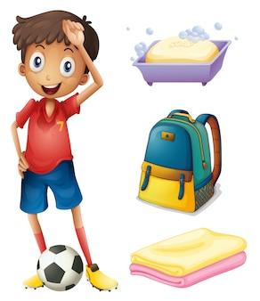 Ein fußballspieler mit seinen rucksack- und badezimmerstoffen