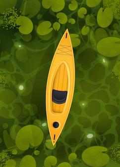 Ein gelbes kajak schwebt durch einen sumpf mit seerosenblättern