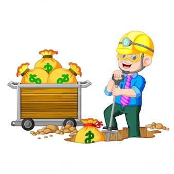 Ein geschäftsmann beim münzbergbau