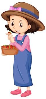 Ein glückliches mädchen mit erdbeeren in der schüssel