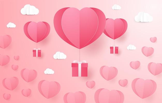 Ein herzförmiger papierkunststil valentinstag origami aus heißluftballon