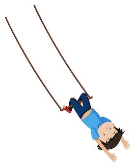 Ein junge auf trapezschaukel