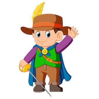 Ein junge trägt musketier kostüm mit schwert