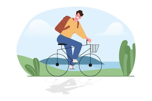 Ein junger mann fährt mit dem fahrrad im freien.