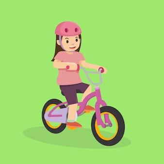 Ein junges mädchen, das fahrrad fährt