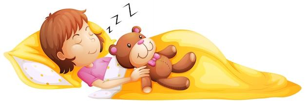 Ein junges mädchen, das mit ihrem spielzeug schläft