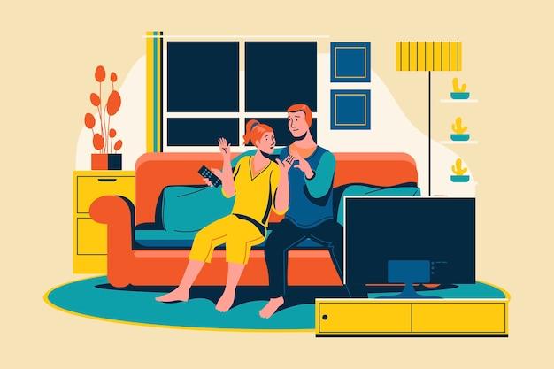 Ein junges paar, das sich entspannt, sieht im wohnzimmer fern