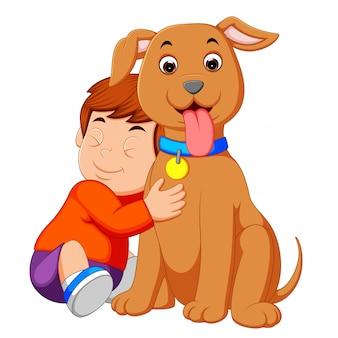 Ein kleiner junge, der seinen hund umarmt