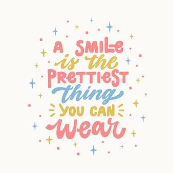 Ein lächeln ist die schönste sache, die sie tragen können, inspirierend hand gezeichnetes beschriftungszitat.