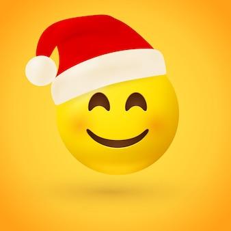 Ein lächelndes gesicht emoji mit roter weihnachtsmannmütze