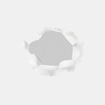Ein loch auf weißem papier mit abgerissenen kanten. loch von einem schuss,