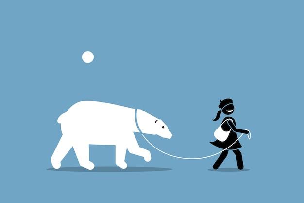 Ein mädchen an der leine und geht mit einem eisbären.
