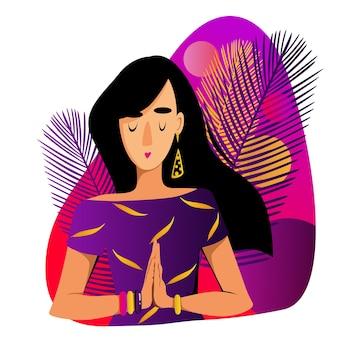 Ein mädchen auf violettem hintergrund faltete ihre hände in einer namaste-position, die einen gesunden lebensstil gymnastik