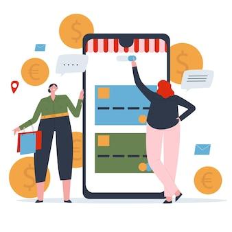 Ein mädchen bezahlt einen einkauf mit ihrem handy eine freundin mit taschen steht neben ihr online-shopping