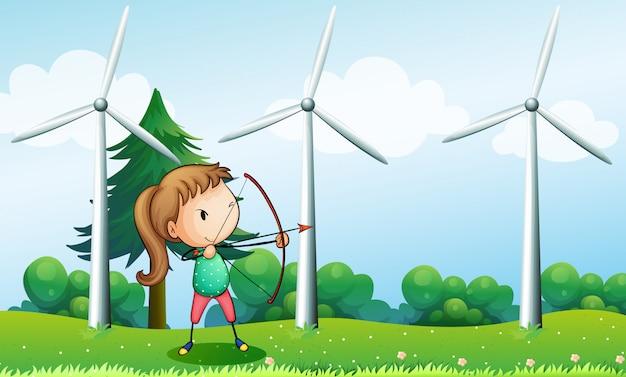 Ein mädchen mit einem bogenschützen nahe den windmühlen