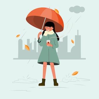 Ein mädchen mit einer tasse kaffee in der hand läuft unter einem regenschirm.