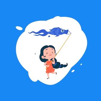 Ein mädchen startet einen drachen in form eines fisches.