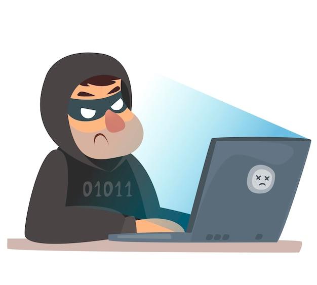 Ein mann an einem computer in einer kriminellen maske computer-hacking-cyberangriff bösewicht hackt die website