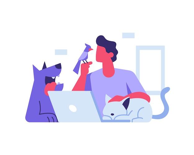 Ein mann arbeitet zu hause in begleitung seiner niedlichen haustiere hund katze und vogel
