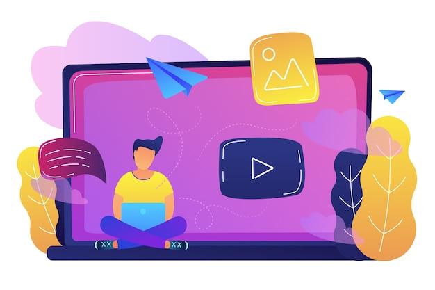 Ein mann, der auf einem großen laptop mit spielknopfillustration sitzt